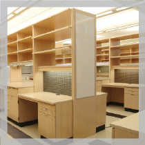 Iris S. & Bert L. Wolstein Research Building: Wood laboratory casework with compartments, attached lab desks and markerboard.