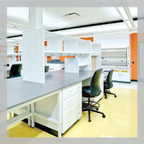 Case Western Reserve University Urology Building: Bright white lab casework, black chairs and fume hood with orange accent wall.